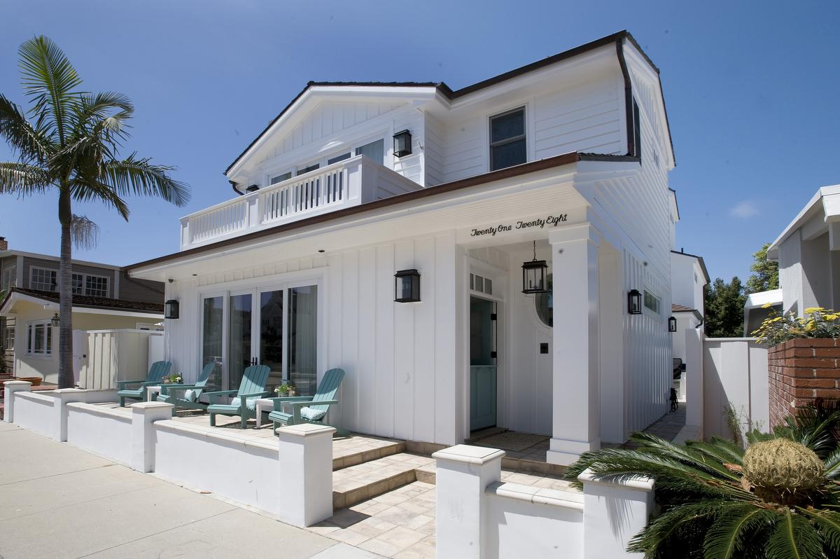 The front of the home on Balboa Peninsula for OCHOME's August hometour. /////// Additional Information - OCHOME.AUGUST.hometour 6/23/15 Photo by Nick Koon / Staff Photographer. Photo of the front of the home featured in the August OCHome hometour on Balboa peninsula.