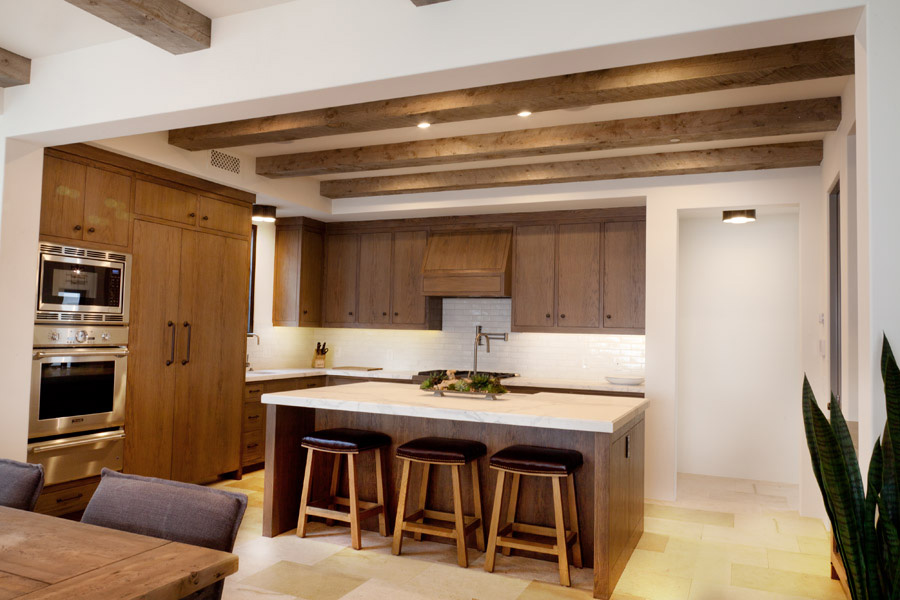 wooden cabinets and wooden ceiling beams